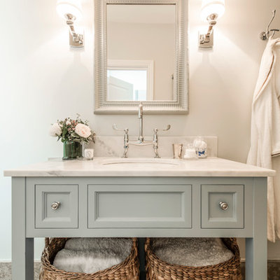Inspiration for a small timeless master bathroom remodel in London with open cabinets, blue cabinets, marble countertops, gray walls and an undermount sink