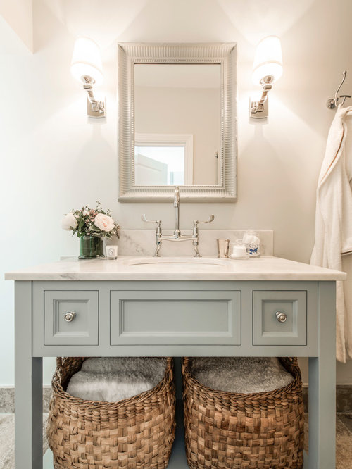 inspiration for a small timeless master bathroom remodel in london with open cabinets blue cabinets