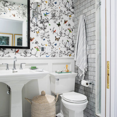 Elegant gray tile and subway tile mosaic tile floor and white floor alcove shower photo in Other with white walls and a pedestal sink