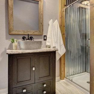 Corner shower - small cottage 3/4 beige floor corner shower idea in Austin with beaded inset cabinets, dark wood cabinets, gray walls, a vessel sink, granite countertops, a hinged shower door and beige countertops
