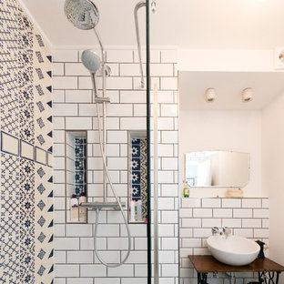 Design ideas for a medium sized mediterranean bathroom in London with freestanding cabinets, black cabinets, a walk-in shower, white tiles, porcelain tiles, white walls, porcelain flooring, a pedestal sink and wooden worktops.