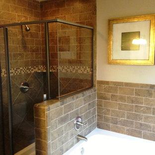 Small elegant master brown tile and ceramic tile ceramic tile bathroom photo in Austin with beige walls