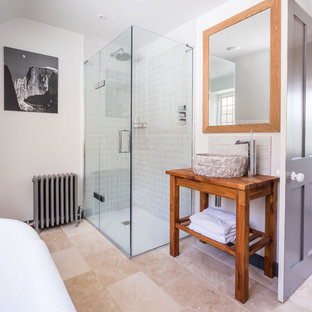 Inspiration for a medium sized traditional bathroom in Other with white walls, a vessel sink, wooden worktops, beige floors, a hinged door, brown worktops, a claw-foot bath, a built-in shower and beige tiles.