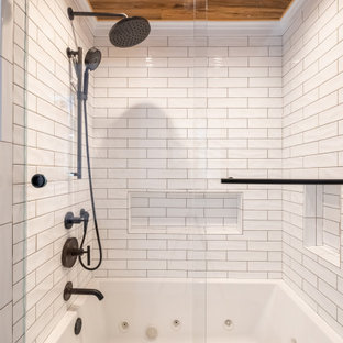 Inspiration for a mid-sized contemporary master white tile and subway tile porcelain floor, gray floor, double-sink and wood ceiling bathroom remodel in Orange County with shaker cabinets, medium tone wood cabinets, a vessel sink, solid surface countertops, black countertops and a built-in vanity