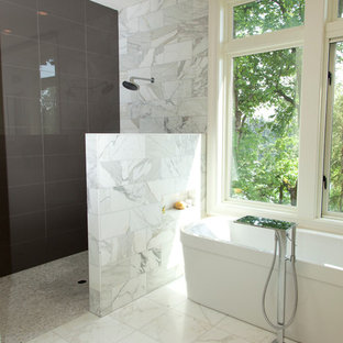 This is an example of a large contemporary ensuite bathroom in Portland with a freestanding bath, a walk-in shower, grey tiles, marble tiles, beige walls, marble flooring, white floors and an open shower.