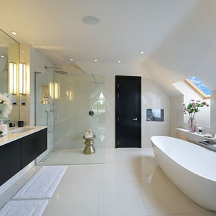 This is an example of a contemporary bathroom in Hertfordshire with flat-panel cabinets, a curbless shower, an undermount sink, dark wood cabinets, an alcove tub, white tile, porcelain tile, white walls, porcelain floors, engineered quartz benchtops and an open shower.