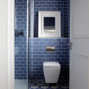 Bathroom - small contemporary master blue tile and subway tile multicolored floor bathroom idea in Dublin with a wall-mount toilet and blue walls