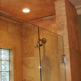 Small tuscan 3/4 brown tile and ceramic tile alcove shower photo in Other with a hinged shower door