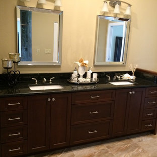 Bathroom - mid-sized traditional master beige tile travertine floor bathroom idea in Tampa with shaker cabinets, dark wood cabinets, a two-piece toilet, beige walls and granite countertops