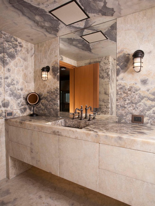 Contemporary Stone Slab Bathroom Idea In Seattle With An Integrated Sink  And Flat Panel Cabinets