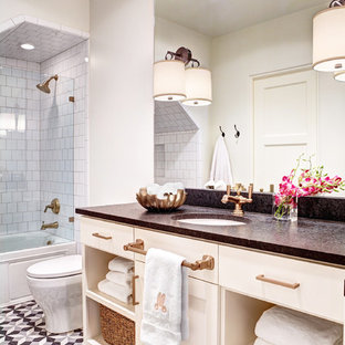 Design ideas for a small mediterranean shower room in Dallas with a submerged sink, shaker cabinets, white cabinets, granite worktops, an alcove bath, a shower/bath combination, a one-piece toilet, black tiles, cement tiles, white walls and terracotta flooring.