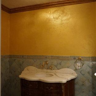 Imagen de cuarto de baño con ducha, vintage, pequeño, con lavabo integrado, armarios tipo mueble, puertas de armario de madera en tonos medios, encimera de mármol, baldosas y/o azulejos blancos, baldosas y/o azulejos de terracota, paredes amarillas y suelo con mosaicos de baldosas