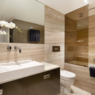 Inspiration for a contemporary brown tile bathroom remodel in Melbourne with flat-panel cabinets, black cabinets, a one-piece toilet and an integrated sink