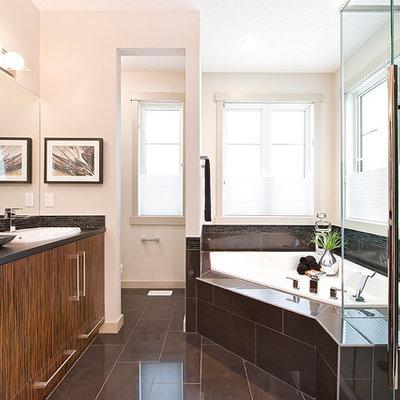 Example of a trendy corner bathtub design in Calgary