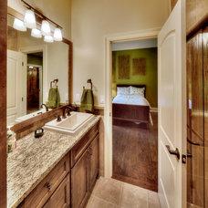 Tropical Bathroom by ALH Home Renovations, LLC