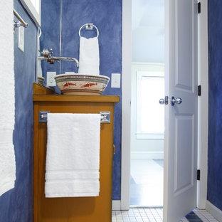 Imagen de cuarto de baño ecléctico con lavabo sobreencimera, armarios tipo mueble, encimera de madera, ducha empotrada, sanitario de dos piezas, baldosas y/o azulejos multicolor, baldosas y/o azulejos de cerámica y puertas de armario amarillas
