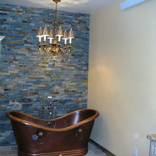 Large southwest master blue tile, multicolored tile and stone tile terra-cotta tile bathroom photo in Denver with an undermount sink, granite countertops and beige walls