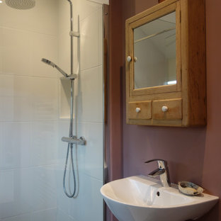 Inspiration for a small eclectic painted wood floor and gray floor doorless shower remodel in Devon with a bidet, pink walls and a pedestal sink