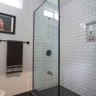 Doorless shower - small industrial 3/4 white tile and ceramic tile porcelain floor doorless shower idea in Los Angeles with white walls
