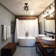 Industrial Bathroom by Frazier Associates