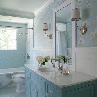 Bathroom - cottage 3/4 white tile and subway tile blue floor bathroom idea in San Francisco with recessed-panel cabinets, blue cabinets, blue walls, an undermount sink and white countertops