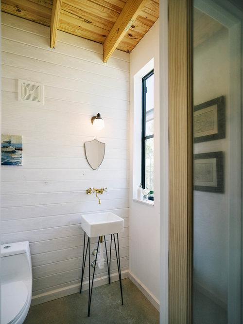 Bathroom   Industrial Concrete Floor Bathroom Idea In Austin With A Console  Sink, A One
