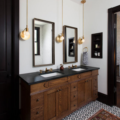 Example of an eclectic master multicolored floor bathroom design in Austin with furniture-like cabinets, dark wood cabinets, white walls and an undermount sink