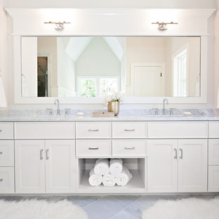 Large trendy master gray tile marble floor bathroom photo in Chicago with an undermount sink, recessed-panel cabinets, white cabinets, beige walls, marble countertops and gray countertops