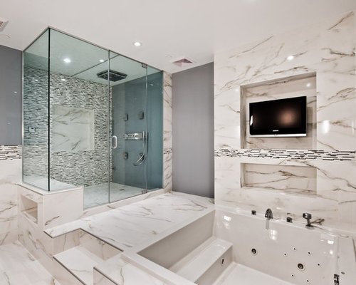 trendy white tile alcove shower photo in new york with a hot tub