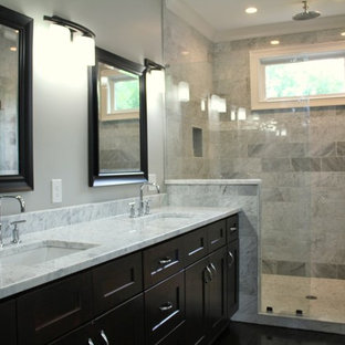 Example of a mid-sized trendy master gray tile and marble tile dark wood floor and brown floor alcove shower design in Atlanta with shaker cabinets, dark wood cabinets, gray walls, an undermount sink, marble countertops, a hinged shower door and gray countertops