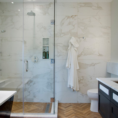 Inspiration for a mid-sized modern master beige tile, white tile and marble tile porcelain tile and brown floor bathroom remodel with shaker cabinets, black cabinets, a one-piece toilet, granite countertops, a hinged shower door, white walls and a trough sink