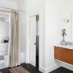 Bathroom - mid-sized scandinavian master white tile and subway tile ceramic tile and brown floor bathroom idea in Austin with flat-panel cabinets, medium tone wood cabinets, white walls, an undermount sink and quartz countertops