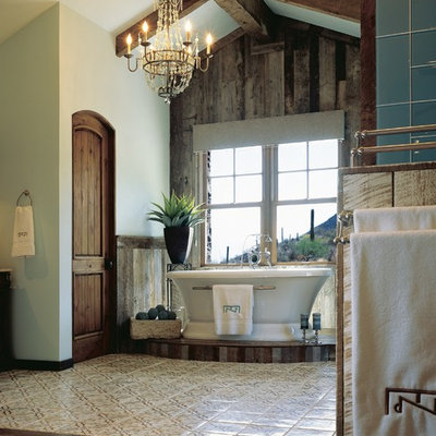 Inspiration for a large southwestern master green tile and glass tile dark wood floor freestanding bathtub remodel in Phoenix with blue walls