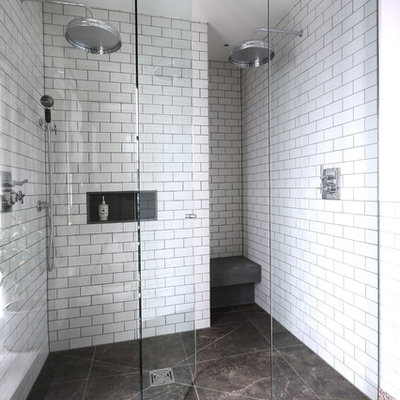 Bathroom - contemporary white tile and subway tile bathroom idea in London with white walls and a niche
