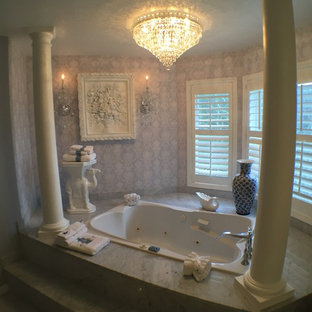 Large traditional master bathroom in Seattle with a hot tub, purple walls and marble floors.