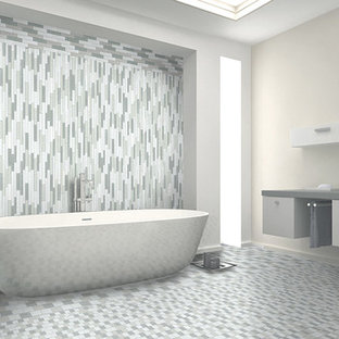 Freestanding bathtub - large contemporary master multicolored tile and ceramic tile ceramic floor freestanding bathtub idea in San Francisco with a vessel sink, flat-panel cabinets, gray cabinets, laminate countertops and white walls