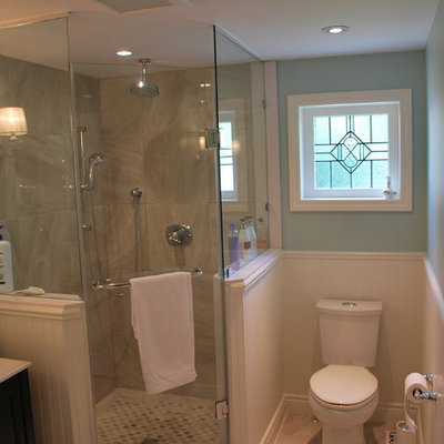 Corner shower - small traditional master beige tile and porcelain tile porcelain tile corner shower idea in Toronto with an undermount sink, furniture-like cabinets, dark wood cabinets, quartz countertops, a two-piece toilet and blue walls