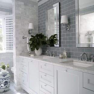 Inspiration for a traditional bathroom in Raleigh with an undermount sink, recessed-panel cabinets, white cabinets and gray tile.