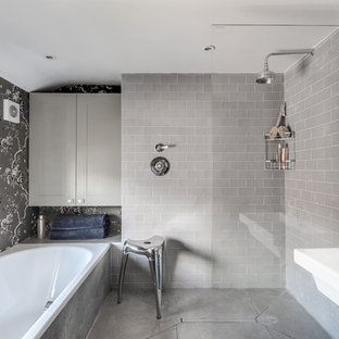 This is an example of a classic ensuite bathroom in Oxfordshire with grey cabinets, an alcove bath, a walk-in shower, grey tiles, grey walls, concrete flooring and an open shower.