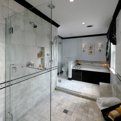 Bathroom - large traditional master subway tile, gray tile and white tile marble floor and gray floor bathroom idea in DC Metro with flat-panel cabinets, black cabinets, a two-piece toilet, gray walls and marble countertops