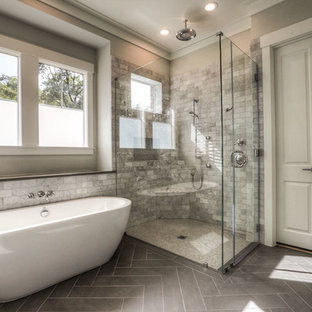 Bathroom - large traditional master white tile and marble tile laminate floor and gray floor bathroom idea in Houston with beige walls and a hinged shower door