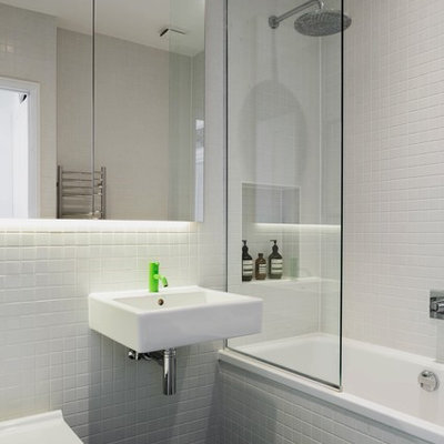 Inspiration for a small scandinavian white tile and ceramic tile cement tile floor and black floor bathroom remodel in London with white walls, a wall-mount sink and a wall-mount toilet