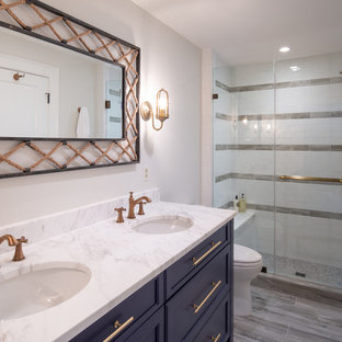 Medium sized coastal family bathroom in Baltimore with recessed-panel cabinets, blue cabinets, white tiles, metro tiles, white walls, ceramic flooring, marble worktops, grey floors, a sliding door and white worktops.