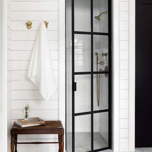 Country white tile and subway tile gray floor alcove shower photo in Seattle with white walls and a hinged shower door