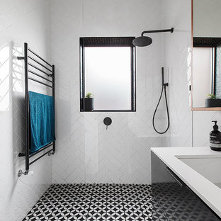 Design ideas for a contemporary 3/4 bathroom in Melbourne with flat-panel cabinets, black cabinets, a curbless shower, a one-piece toilet, white tile, porcelain tile, white walls, an undermount sink, an open shower and white benchtops.