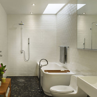 Inspiration for a modern subway tile pebble tile floor bathroom remodel in Philadelphia