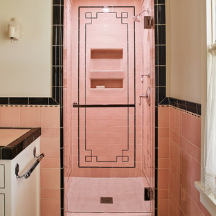 Elegant pink tile pink floor alcove shower photo in Los Angeles with pink walls, a hinged shower door and white cabinets