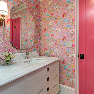 Design ideas for a country bathroom in Charlotte with beaded inset cabinets, beige cabinets, pink walls and an undermount sink.