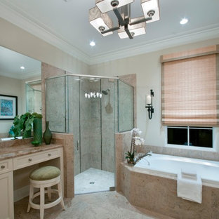 Eclectic beige tile bathroom photo in Miami with an undermount sink, recessed-panel cabinets and beige cabinets