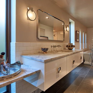 Bathroom - large mid-century modern master white tile and ceramic tile porcelain floor bathroom idea in Seattle with flat-panel cabinets, white cabinets, white walls, an undermount sink and marble countertops